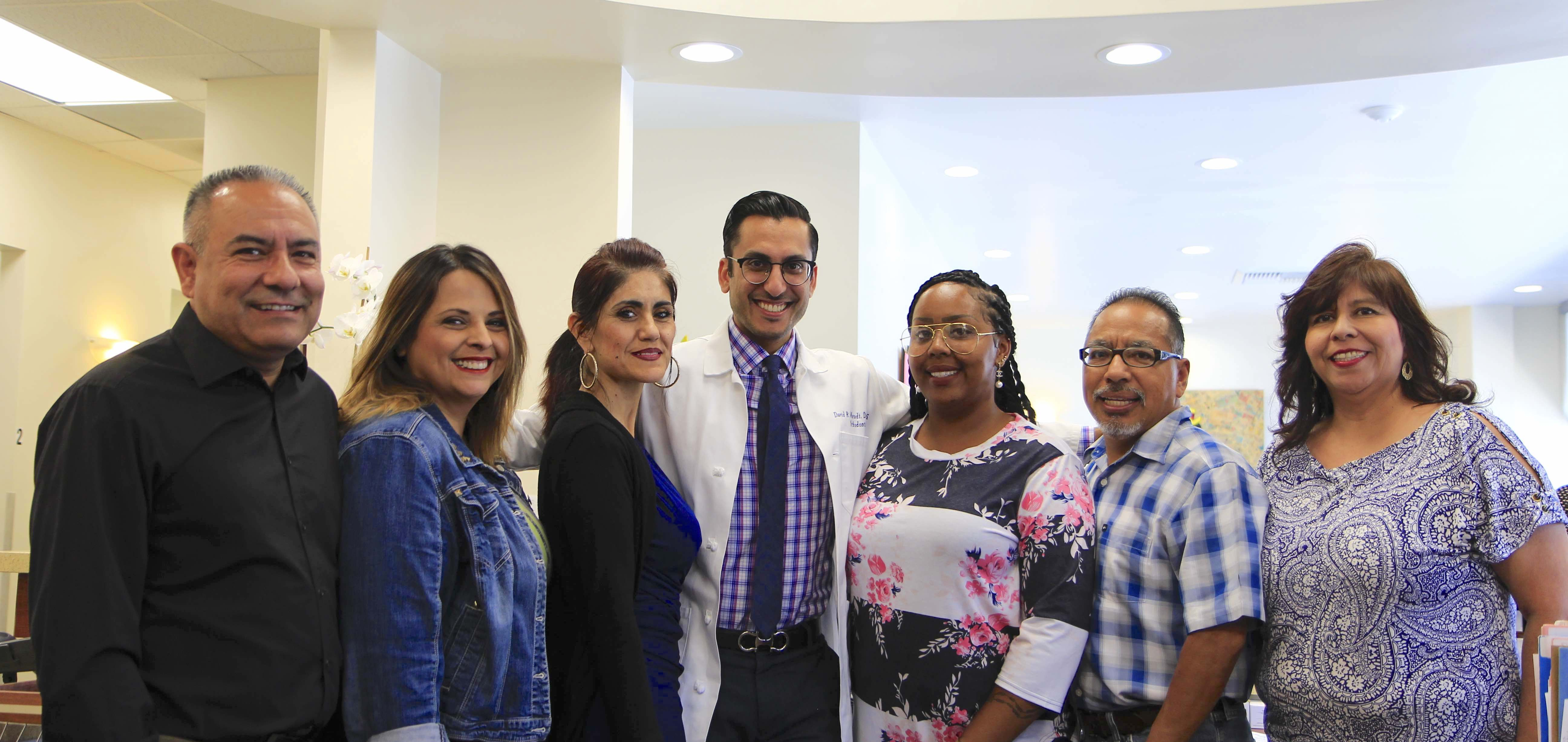 photo of dr. moradi,board certified dentist, and office staff at Frankel Dental Group in Culver City